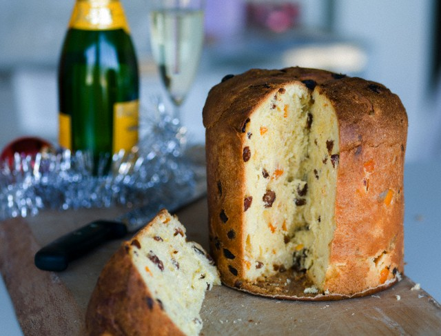 Close-up of panettone with a champagne bottle