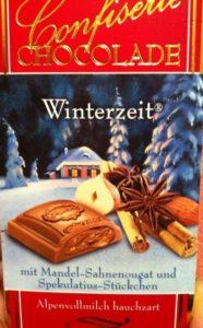 Cioccolato al latte con ripieno di cannella, nocciola, mandorle